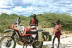 1990_KENYA_native Massais in Amboseli National Park meet BMW motorcycle_2 different worlds_they were staring one hour alternately to the bike, to me and the other way round_they couldn´t really believe it, that somebody crossed their wild National-Park with such a huge motor- cycle