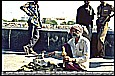 1995_INDIA_BOMBAY (Mumbai)_be careful_a snake charmer with some cobras_my motorcycle-trip around the world_Jochen A. Hübener